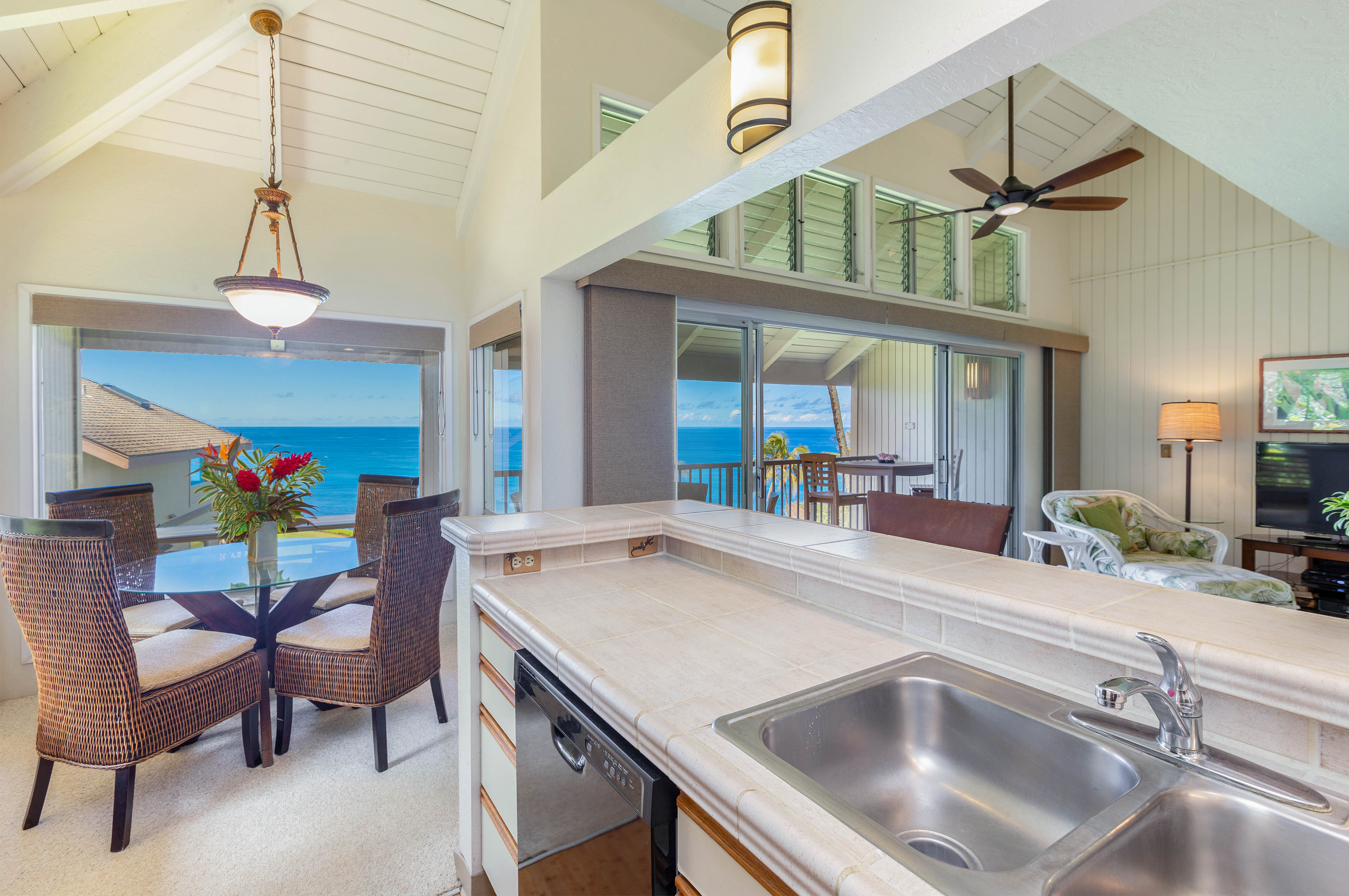 princeville-vacations pali ke kua 207 - kitchen with dining view